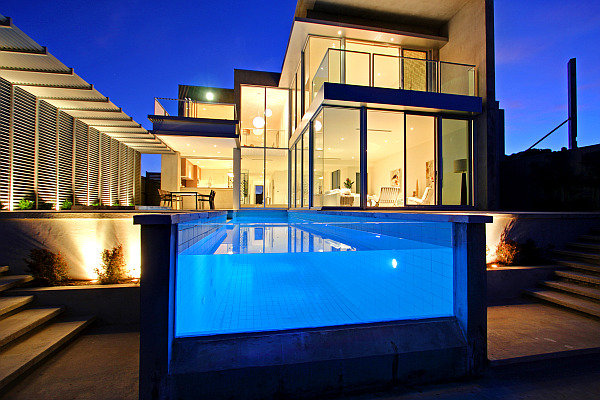 Luxury beach house with fancy pool and stunning lighting