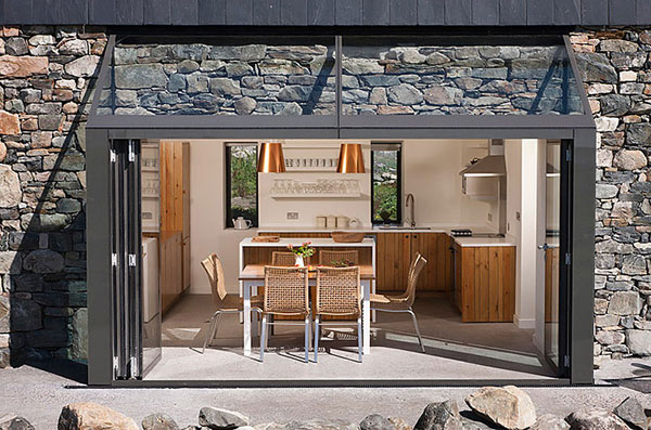 Modern Stone Hut – cottage dining room