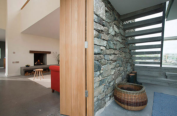 Modern Stone Hut – cottage fireplace and stone walls