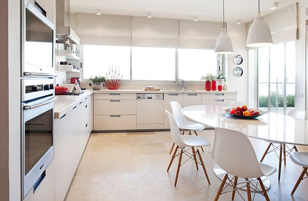 White Kitchen With Oval Shaped Table And Eames Chairs Decoist