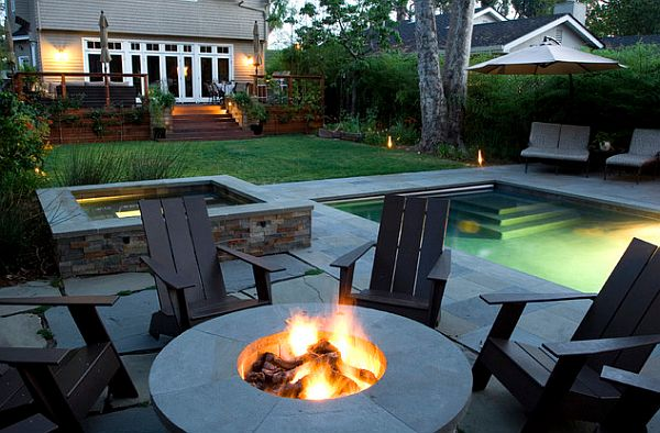 backyard retreat with fancy chairs a firepit and a lap pool How to Create Your Own Backyard Retreat
