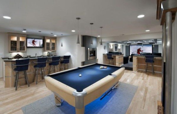 basement open floorplan with contemporary furniture 600x387 DIY Caving: Manning Up to Cave Your Basement