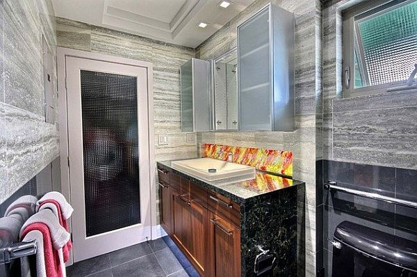 bathroom with vein-cut silver travertine, cast glass & LED lighting