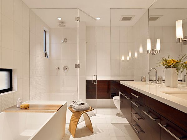 bathroom with wooden vanity and glass shower screen