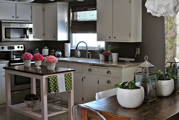 grey-kitchen-with-white-cabinets-and-small-island-table