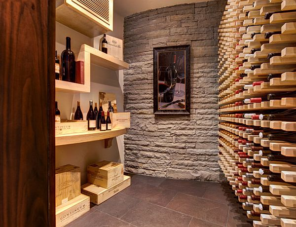 fancy wine cellar with exposed walls by kessick wine cellars