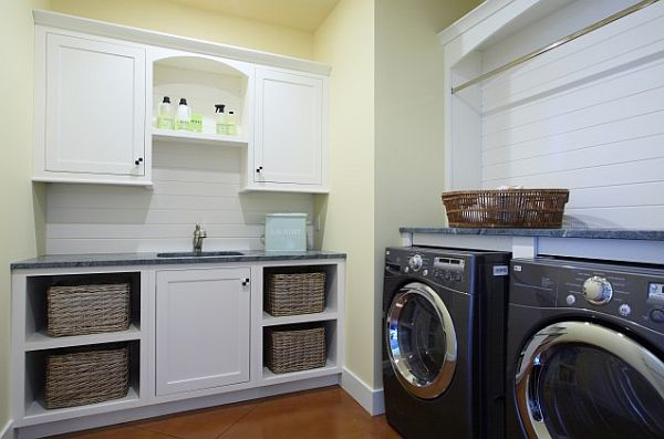 laundry room with white cabinets and baskets