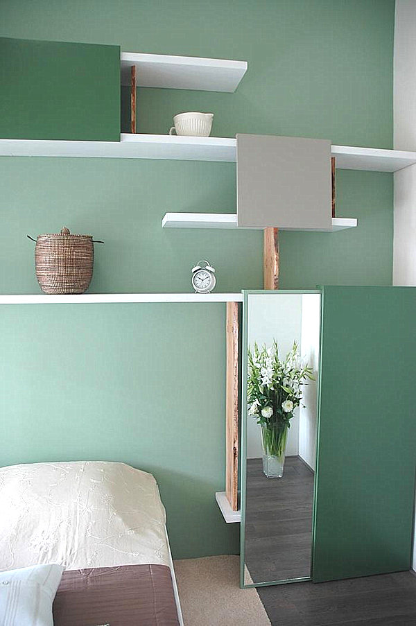 mint green room and shelving