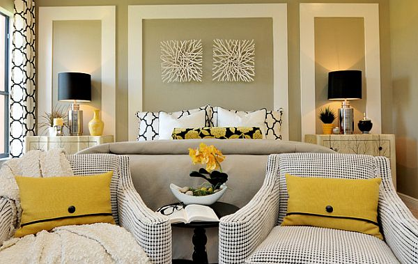 sleek bedroom design with yellow pillows and comfy chairs
