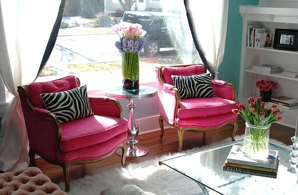 traditional living room with pink chairs