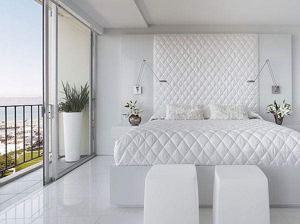 white bedroom with white flooring - Bed quilt and head board