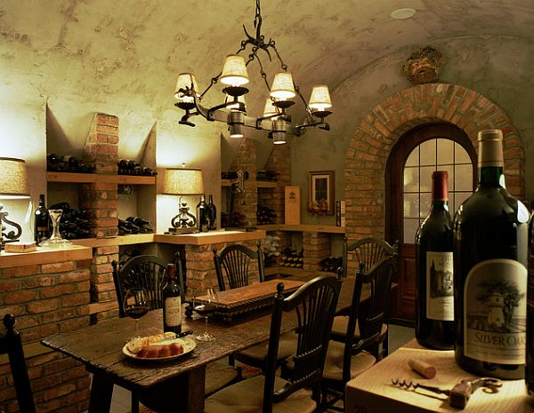 wine cellar with a table and rounded ceiling