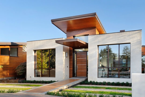 Contemporary green home charms with sleek pool and mini golf course Sleek homes that are unapologetically modern