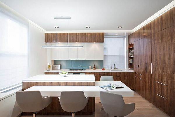 Kitchen with walnut veneered cabinetry with white furniture How to Design a Kitchen for Multiple Chefs