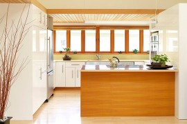Kitchen with white cabinets and wood tone island