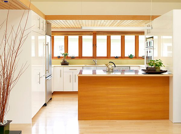 view in gallery kitchen with white cabinets and wood tone island 10 types of wood for your interiors