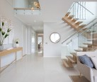 Modern wooden stairs with glass panel balustrade