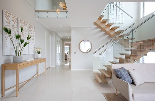 Modern wooden stairs with glass panel balustrade Seven Methods to Top the Scale of Interior Stairways