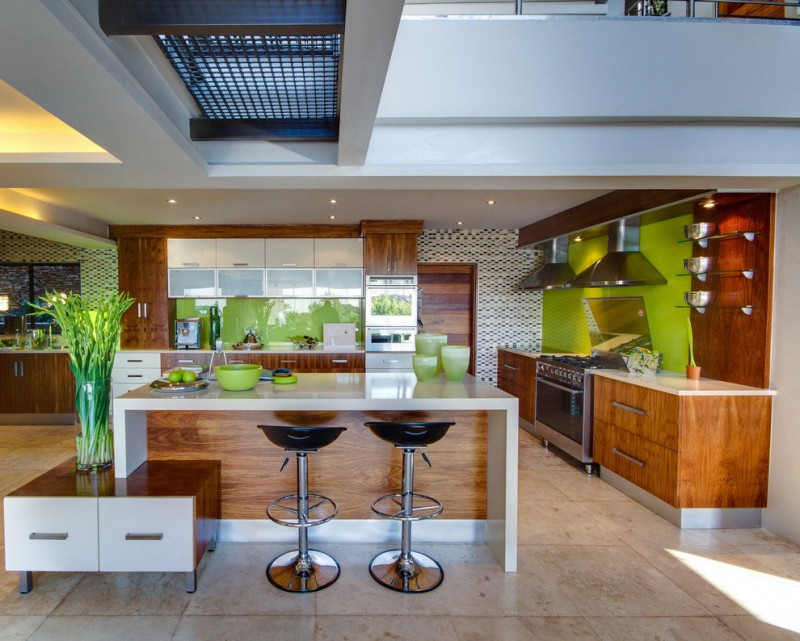 South African House Remodeling – large open space kitchen with white and green