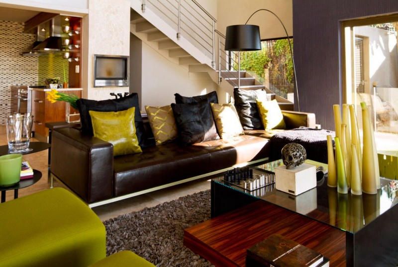 South African House Remodeling – modern living room with green accents