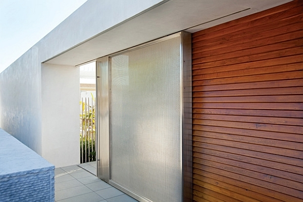 Southern California home wooden door Modern living space in California amalgamates contrasting design styles with ease
