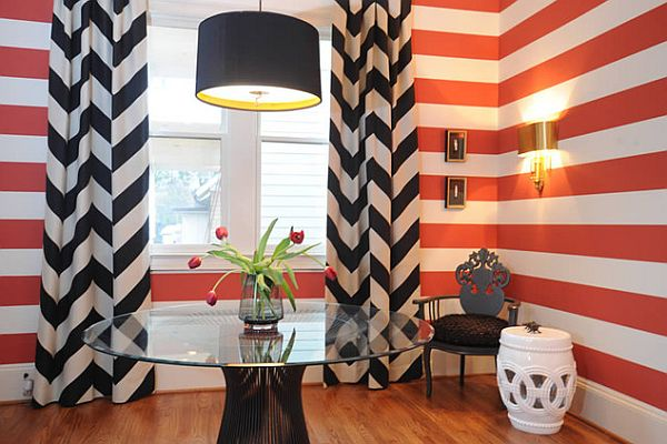 Black curtains and red wall stripes for a perfect modern match