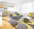 colorful living room with grey and yellow themes