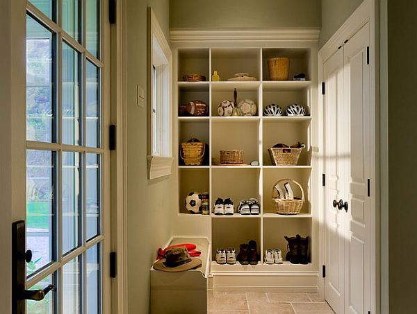 crisp-mudroom-with-white-doors-and-shelves