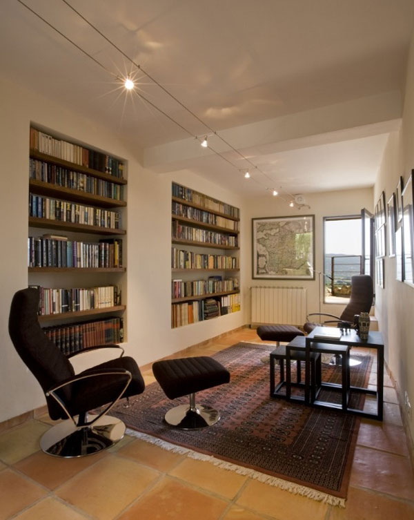 home library with wall encapsulated shelves