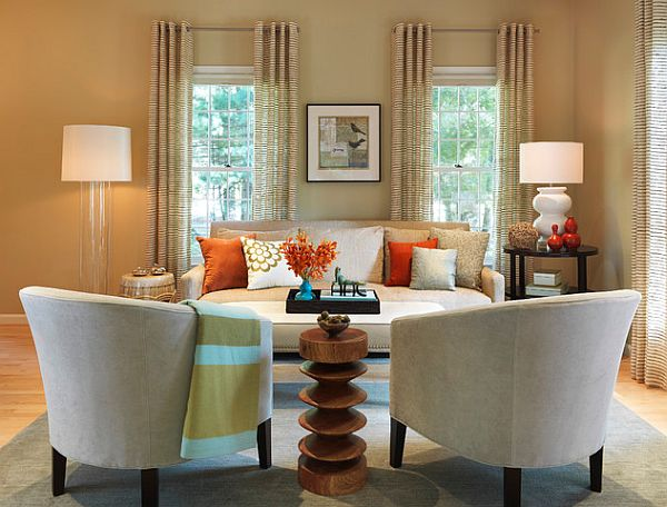 living room with orange tan and white accents How to Mix Patterns Appropriately