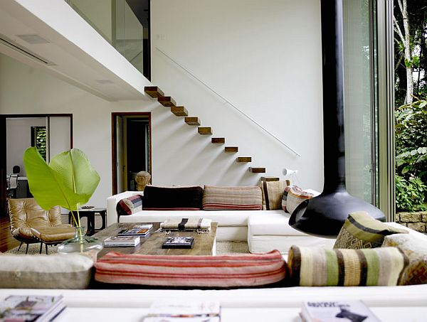 Seven methods to top the scale of interior stairways for Living room designs with stairs