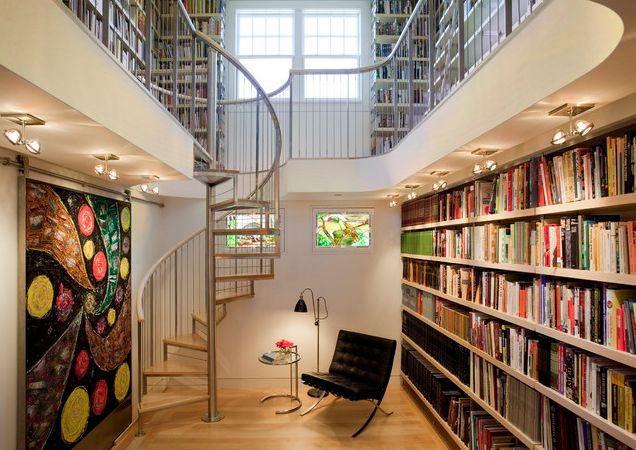 modern library design for your home with spiraling staircase