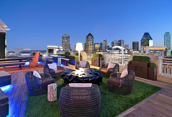 modern rooftop design with grass rug and confy rattan chairs Decorating a Rooftop Space in Five Easy Steps