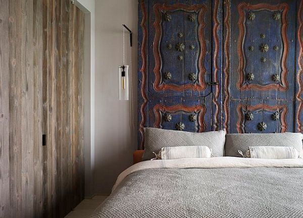 Old door turned into a fancy bed headboard
