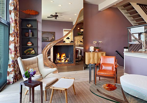 Purple wall and orange accents for a trendy living room