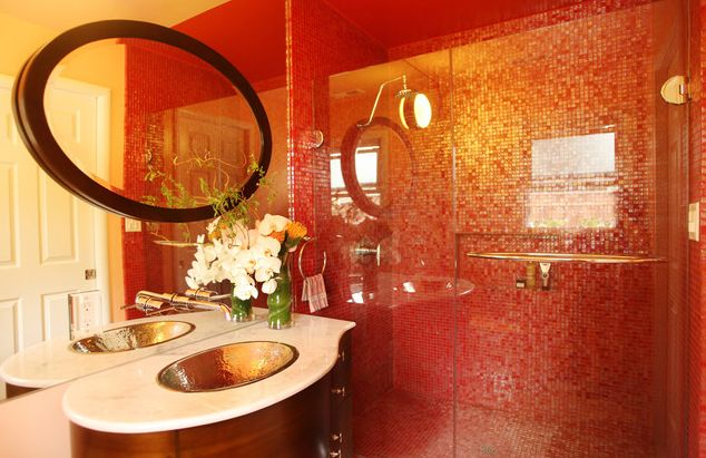 red bathroom design with red glass tile, marble and walnut vanity