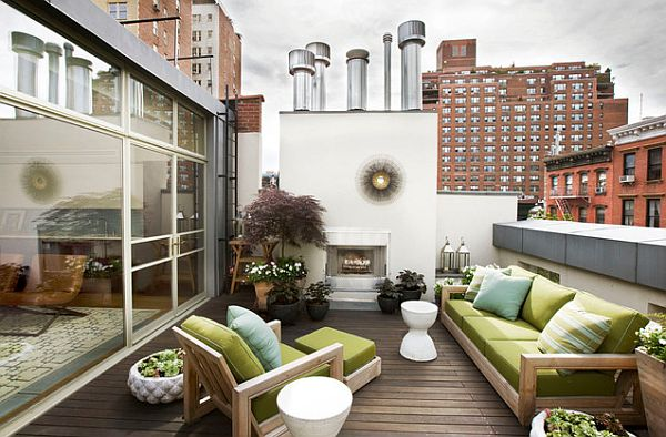roof terrace with outdoor fireplace, teak furniture and a container garden