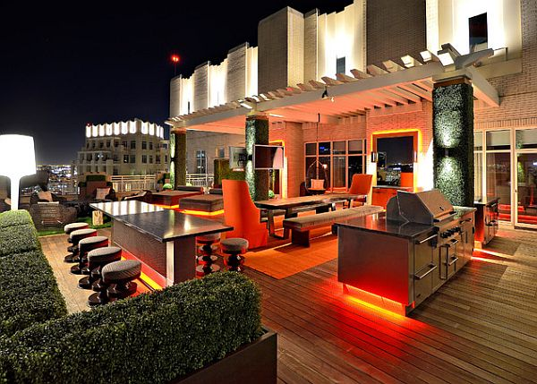 rooftop terrace with glowing neon furniture and small garden