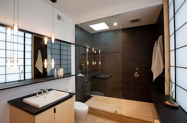stylish bathroom with black tile and roman shower