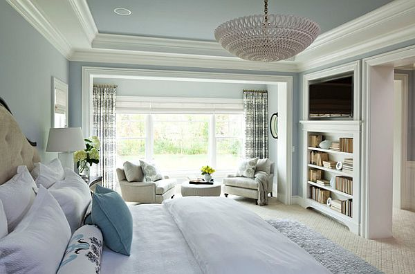 tranquil master bedroom suite with seating area and bookcase tv stand