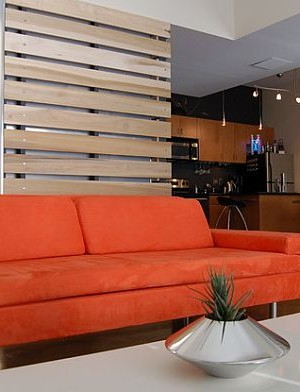 ultra modern living room with pallet board wall