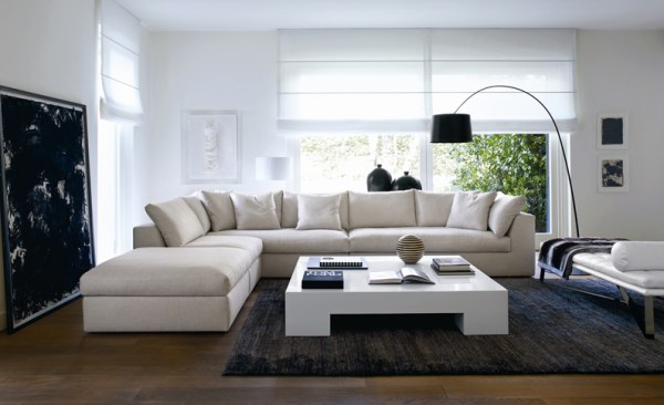 Design L-shaped living room couch and white square table