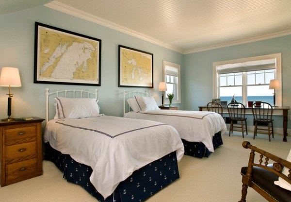 A nautical guest room with two beds