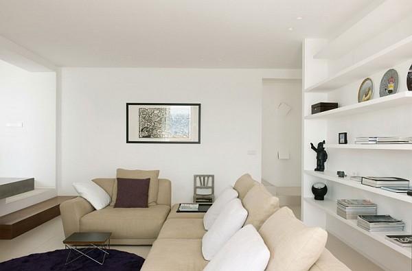 Bright living room wih cream L-shape sofa
