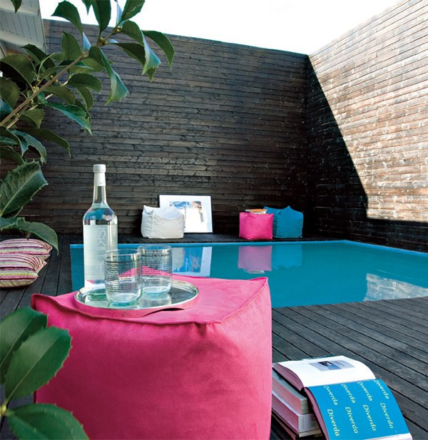 Colorful poolside cushions Decked Out: Stay Cool by the Pool With These Fabulous Terrace Design Ideas