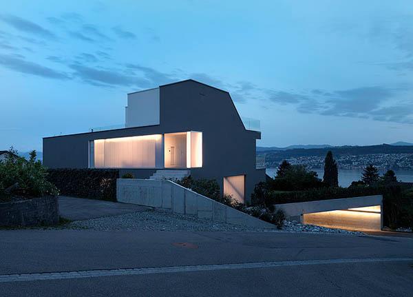Feldbalz house contemporary glass home with brilliant for Modern house zurich