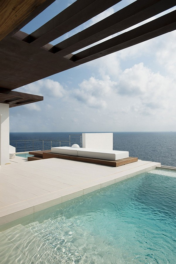 Ibiza villa with pool and day bed on the terrace Minimalistic Spanish Home Offers Stunning Views of the Sea & a Refreshing Dip in Its Breathtaking Pool
