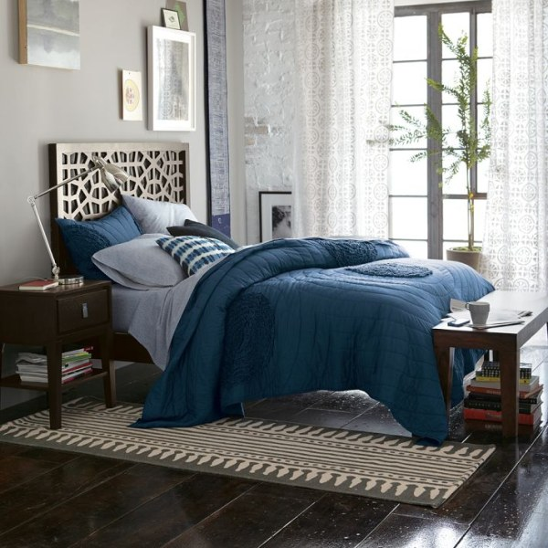 a light and airy bedroom with blue bedding
