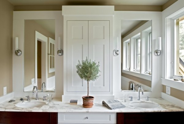 a modern bathroom with a topiary centerpiece