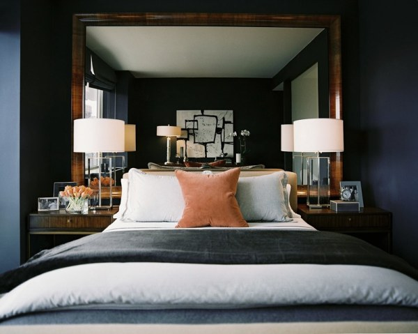 a pair of lamps and nightstands in an elegant bedroom